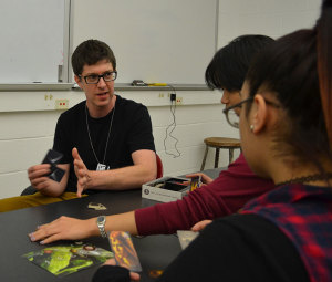 CCNY Professor and game developer Ethan Ham and two of his students play Avalon, a social deduction game.
